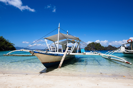 tourist destinations: EL NIDO, PHILIPPINES - FEBRUARY 06, 2014 : Boats waiting for tourists to travel between the islands. El Nido is one of the top tourist destinations in the world.