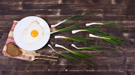 Egg , chives,  plate, knife and fork look like sperm competition, Spermatozoons floating to ovule photo
