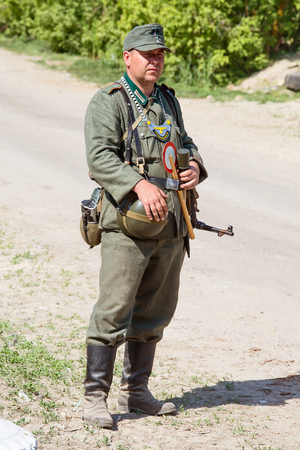 KIEV, UKRAINE - MAY 11, 2013 :Unidentified member of Red Star history club wears historical German uniform during historical reenactment of WWII