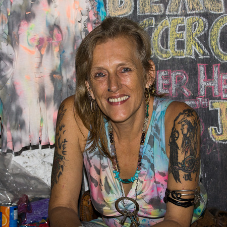 PHANGAN - JANUARY 26: An unidentified old woman attends the full moon party, on Jan 26, 2013 in Koh Phangan , Thailand . The event now draws a crowd of about 20,000-30,000 every full moon evening.