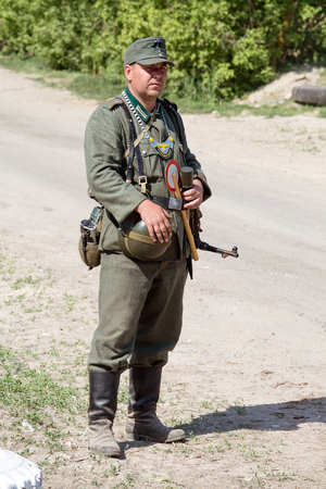 wehrmacht: KIEV, UKRAINE -MAY 11: Member of Red Star history club wears historical German uniform during historical reenactment of WWII, May 11, 2013 in Kiev, Ukraine