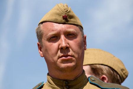 KIEV, UKRAINE - MAY 11 : Member of Red Star history club wear historical Soviet uniform during historical reenactment of WWII on May 11, 20113 in Kiev, Ukraine Editorial