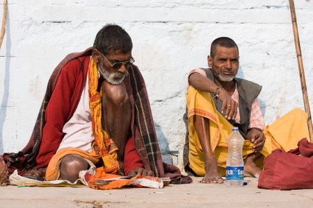 VARANASI, INDIA - DECEMBER 1: An unidentified sadhu sits on the ghat along the Ganges on December 1, 2012 in Varanasi, India. Tourism has drawn many alleged fake sadhus to Varanasi Stock Photo - 29099806