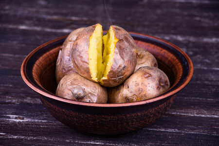 unpeeled: Ukrainian national dish is baked potatoes in plate Stock Photo