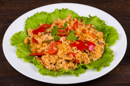 Rice with vegetables and chicken in a curry sauce photo