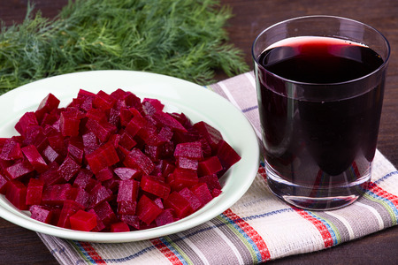 Fresh segments of a beet and beetroot juice , close up photo