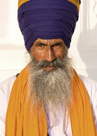 Portrait of Indian sikh man in turban with bushy beard photo