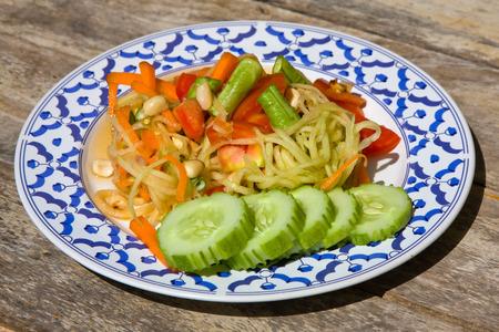 Thai papaya salad also known as Som Tam from Thailand. photo