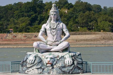 RISHIKESH, INDIA-OCTOBER 24, 2012 : Statue Shiva, hindu idol on the river Ganges