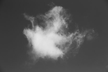 Abstract design of white powder cloud against dark background photo