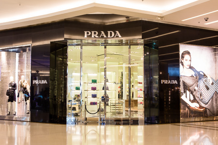prada: BANGKOK,THAILAND - NOVEMBER 19, 2013 : Front view of Prada store in Siam Paragon Mall. With 300,000 sq m of retail space Siam Paragon is one of the worlds largest malls.