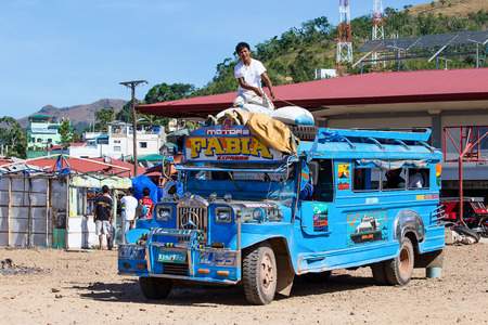 means of transportation: CORON, PHILIPPINES - FEBRUARY 07, 2014 :Jeepneys passing, Philippines inexpensive bus service. Jeepneys are the most popular means of public transportation in the Philippines.