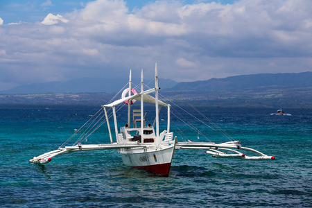 apo: APO, PHILIPPINES - FEBRUARY 14, 2014 : Boats waiting for tourists to travel between the islands. Philippines is one of the top tourist destinations in the world. Editorial