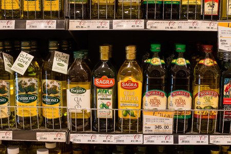 BANGKOK,THAILAND - NOVEMBER 19, 2013:Selection of olive oil on the shelves in a supermarket Siam Paragon. With 300,000 sqm of retail space Siam Paragon is one of the worlds largest malls