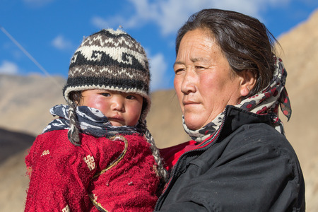the descendant: LADAKH, INDIA - SEPTEMBER 09 2014: Unidentified local woman with the child, outdoor in Ladakh. The majority of the local population are descendant of Tibetan. Editorial