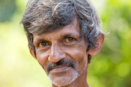 underprivileged: MATARA, SRI LANKA - NOVEMBER 10, 2014: Unidentified old Sri Lankan beggar waits for alms on a street