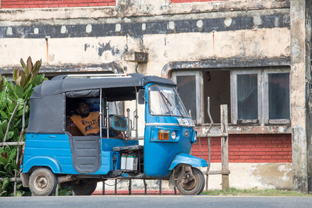 auto rickshaw: HIKKADUWA, SRI LANKA - NOVEMBER 11, 2014: Auto rickshaw or tuk-tuk on the street of Hikkaduwa. Most tuk-tuks in Sri Lanka are a slightly modified Indian Bajaj model, imported from India.