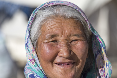 the descendant: LADAKH, INDIA - SEPTEMBER 09 2014: Old unidentified local woman, outdoor in Ladakh. The majority of the local population are descendant of Tibetan.
