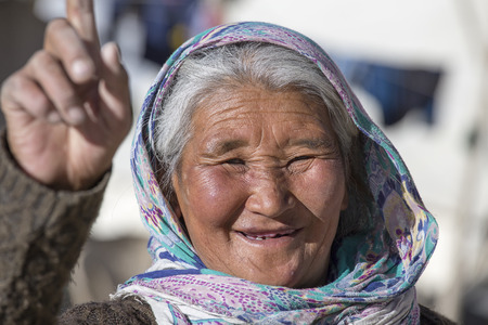 majority: LADAKH, INDIA - SEPTEMBER 09 2014: Old unidentified local woman, outdoor in Ladakh. The majority of the local population are descendant of Tibetan.