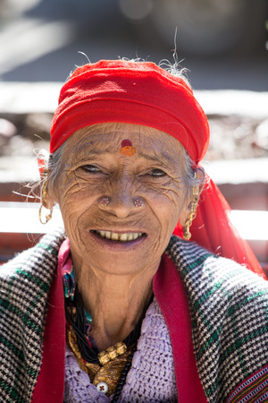 majority: MANALI, INDIA, 15 SEPTEMBER 2014: Old unidentified local woman, outdoor in Manali . The majority of the local population are descendant of Tibetan. Editorial