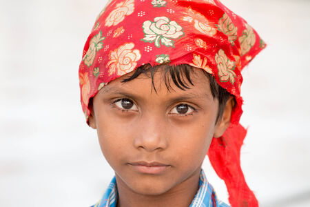 sikh: AMRITSAR, INDIA - SEPTEMBER 26, 2014: Unidentified young Sikh boy visiting the Golden Temple in Amritsar, Punjab, India. Sikh pilgrims travel from all over India to pray at this holy site.