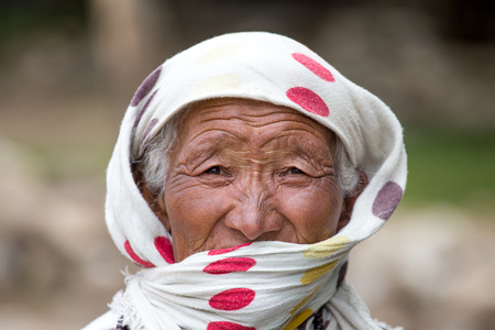 majority: LEH IN LADAKH, INDIA - SEPTEMBER 03 2014: Old unidentified local woman, outdoor in Leh. The majority of the local population are descendant of Tibetan. Editorial