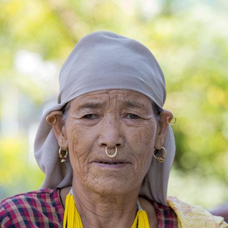 devprayag: DEVPRAYAG, INDIA - OCTOBER 13, 2014 : Unidentified Indian woman visits the sacred river Ganges. Poor Indians flock to Devprayag for charity.
