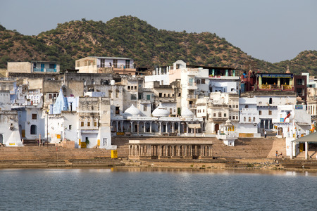 PUSHKAR, INDIA - OCTOBER 23 2014: Holy ghats at sacred Sarovar lake. Pushkar - famous worship place in India