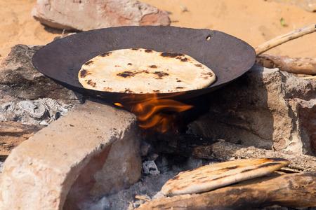 paratha: Indian chapatti on fire, Pushkar, India