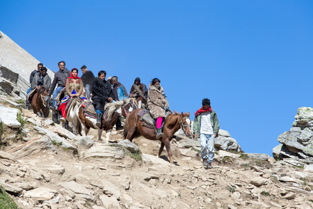 ROHTANG, INDIA - SEPTEMBER 17 2014: Unidentified tourists having fun on the Rohtang Pass, which is on the road Manali - Leh.  India, Himachal Pradesh