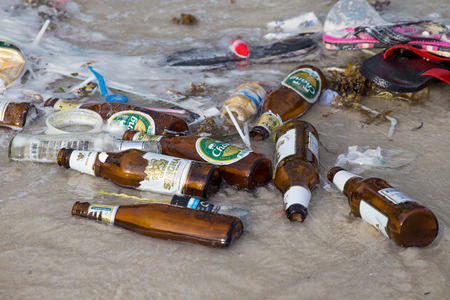 rin: KOH PHANGAN,THAILAND - DECEMBER 7, 2014: Consequences of sea water pollution on the Haad Rin beach after the full moon party.