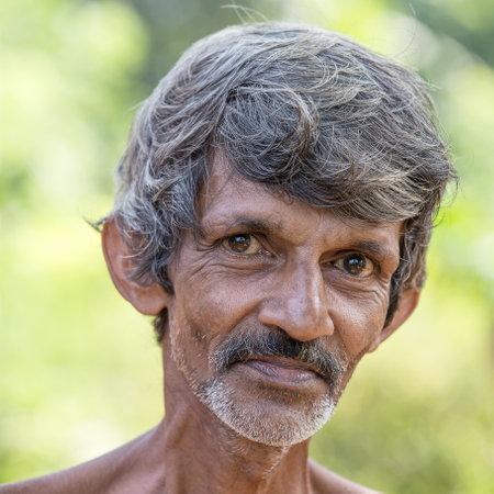MATARA, SRI LANKA - NOVEMBER 10, 2014: Unidentified old Sri Lankan beggar waits for alms on a street