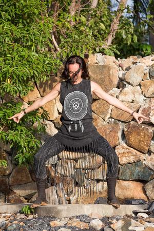 shamanic: Young woman doing shamanic dance in nature