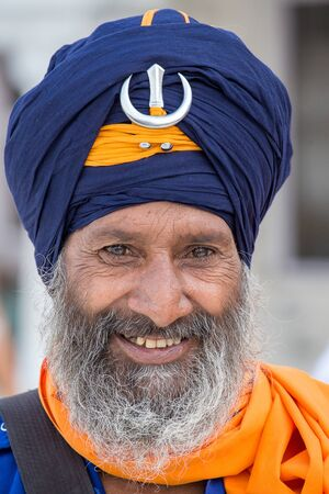 AMRITSAR, INDIA - SEPTEMBER 27, 2014: Unidentified Sikh man visiting the Golden Temple in Amritsar, Punjab, India. Sikh pilgrims travel from all over India to pray at this holy site.