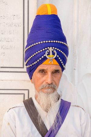 sikh: AMRITSAR, INDIA - SEPTEMBER 27, 2014: Unidentified Sikh man visiting the Golden Temple in Amritsar, Punjab, India. Sikh pilgrims travel from all over India to pray at this holy site.