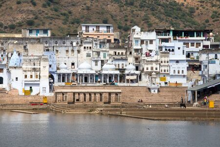 PUSHKAR, INDIA - OCTOBER 24, 2014: Holy ghats at sacred Sarovar lake. Pushkar - famous worship place in India