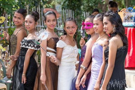 apo: APO, PHILIPPINES - FEBRUARY 12, 2014 : Unidentified filipino students in the school yard have a masquerade ball