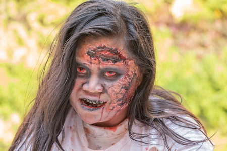 ugly girl: BANGKOK,THAILAND - JANUARY 8, 2015: Unknown Thai girl participates in FOX Thai The Walking Dead Season 5 Marathon dressed as zombies
