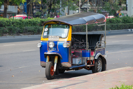 auto rickshaw: BANGKOK,THAILAND - JANUARY 8, 2015:  Auto rickshaw or tuk-tuk on the street of Bangkok.Tuk tuks are commonly used in transporting people and goods around the capital
