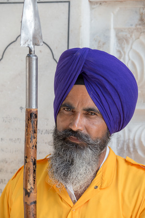 AMRITSAR, INDIA - SEPTEMBER 28, 2014: Unidentified Sikh man visiting the Golden Temple in Amritsar, Punjab, India. Sikh pilgrims travel from all over India to pray at this holy site.