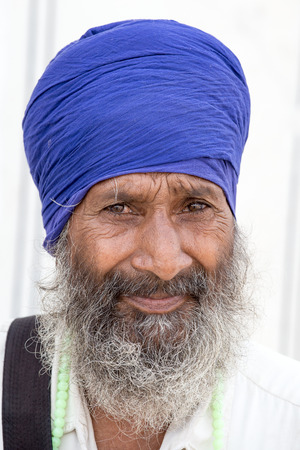 sikh: AMRITSAR, INDIA - SEPTEMBER 28, 2014: Unidentified Sikh man visiting the Golden Temple in Amritsar, Punjab, India. Sikh pilgrims travel from all over India to pray at this holy site.