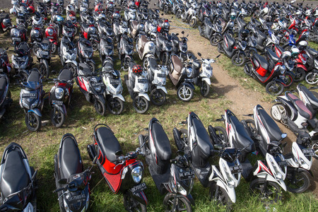 UBUD, INDONESIA - FEBRUARY 18, 2015 : Motorbike parking on the street. There is nearly 1 million of motorbikes in the whole city.