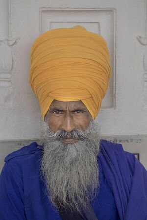 Portrait of Indian sikh man in turban with bushy beard photo
