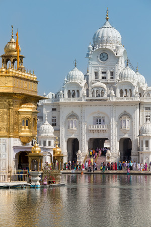sikh: AMRITSAR, INDIA - SEPTEMBER 29, 2014: Unidentified Sikh and indian people visiting the Golden Temple in Amritsar, Punjab, India. Sikh pilgrims travel from all over India to pray at this holy site.