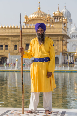 AMRITSAR, INDIA - SEPTEMBER 29, 2014: Unidentified Sikh man visiting the Golden Temple in Amritsar, Punjab, India. Sikh pilgrims travel from all over India to pray at this holy site.