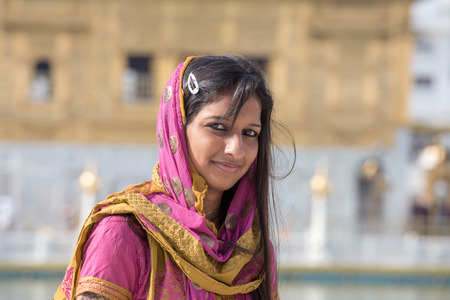 pilgrim costume: AMRITSAR, INDIA - SEPTEMBER 29, 2014: Unidentified Rajasthani woman visiting the Golden Temple in Amritsar, Punjab, India. Sikh pilgrims travel from all over India to pray at this holy site.