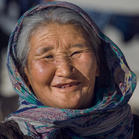 descendant: LADAKH, INDIA - SEPTEMBER 09 2014: Old unidentified local woman, outdoor in Ladakh. The majority of the local population are descendant of Tibetan.