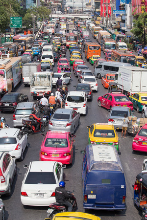 congested: BANGKOK, THAILAND - JANUARY 22, 2015: Traffic moves slowly along a busy road in Bangkok, Thailand. Annually an estimated 150,000 new cars join the already heavily congested streets of Bangkok.