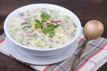 cold meal: Close-up of russian cold vegetable soup on yogurt, sour-milk base -  okroshka Stock Photo