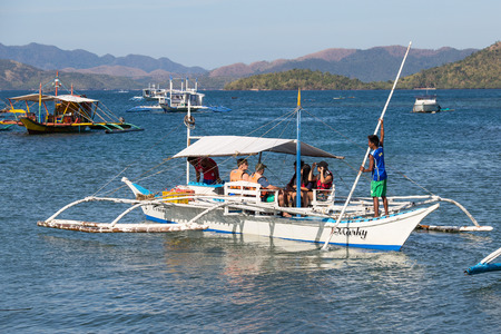 coron: CORON, PHILIPPINES - FEBRUARY 07, 2014 : Boats waiting for tourists to travel between the islands. Philippines is one of the top tourist destinations in the world.